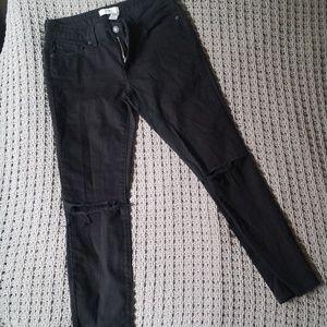 Black split knee distressed skinny jeans